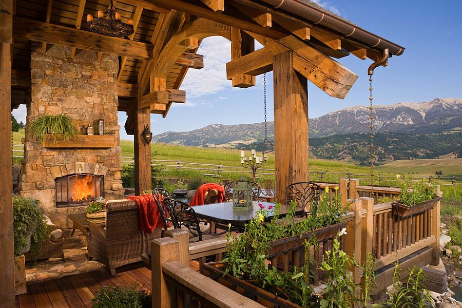 Stone fireplace and a cozy sitting area for the rustic deck [Design: Locati Architects]