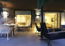 Stone-walls-and-glass-windows-blend-contrasting-textures-seamlessly-217x155