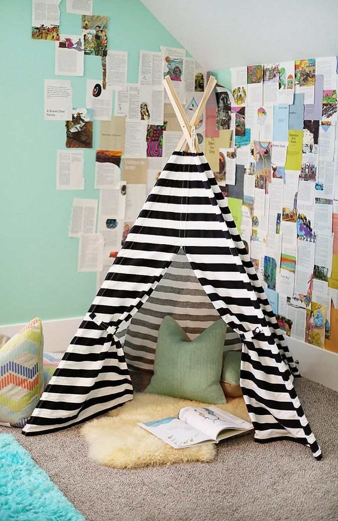 Striped teepee as a reading nook in a corner of the room