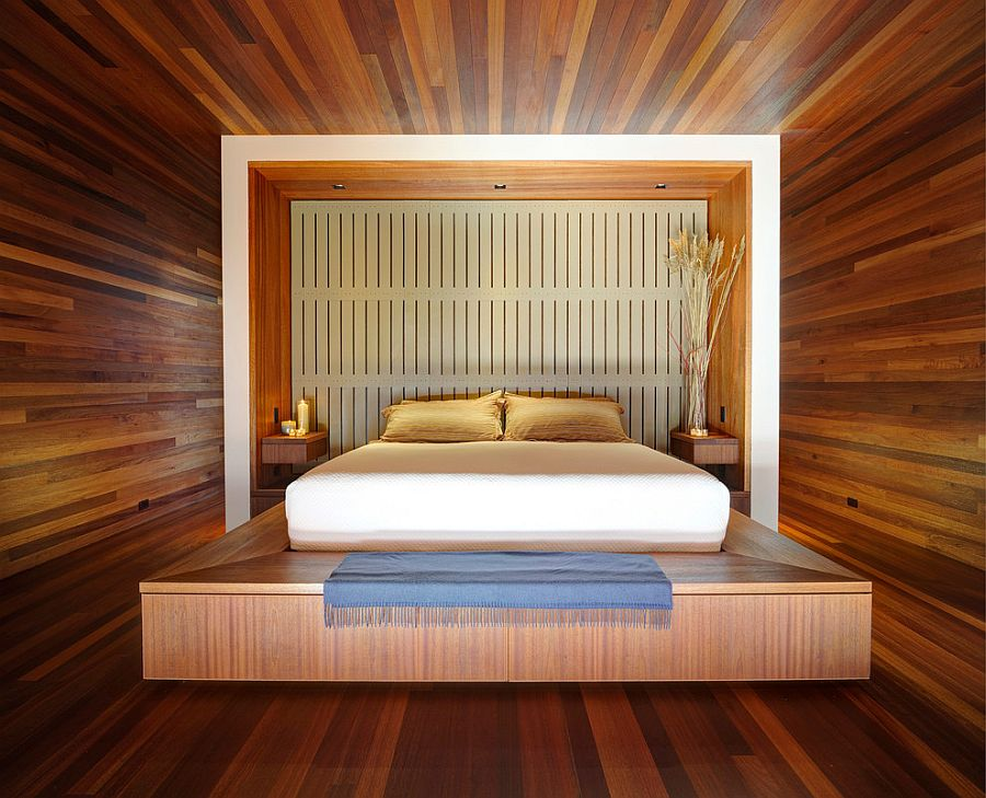 Stunning mahogany-lined master bedroom with platform bed