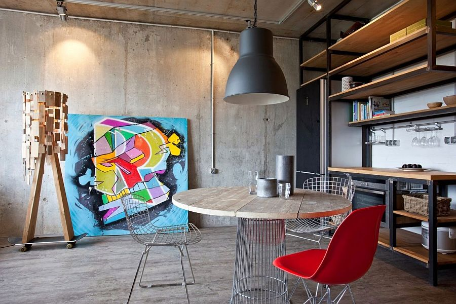 Stylish studio apartment living room with exposed concrete wall Small Modern Industrial Apartment Draped in Metal, Wood and Brick