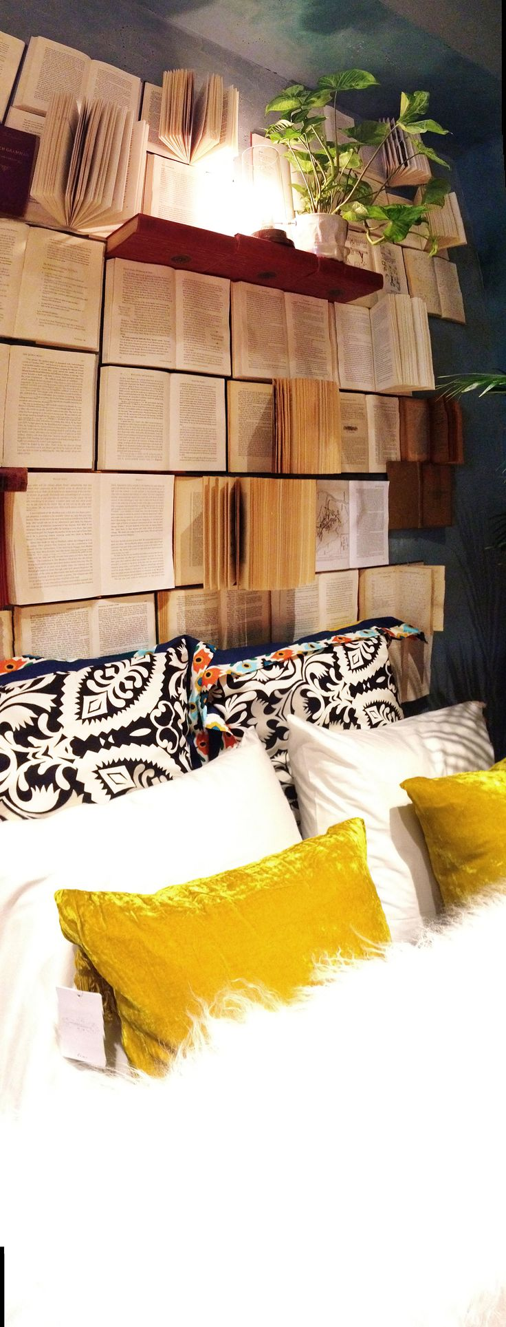 Super creative headboard made of actual books