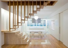 Suspended timber steps create a wonderfully unique staircase for the minimal home