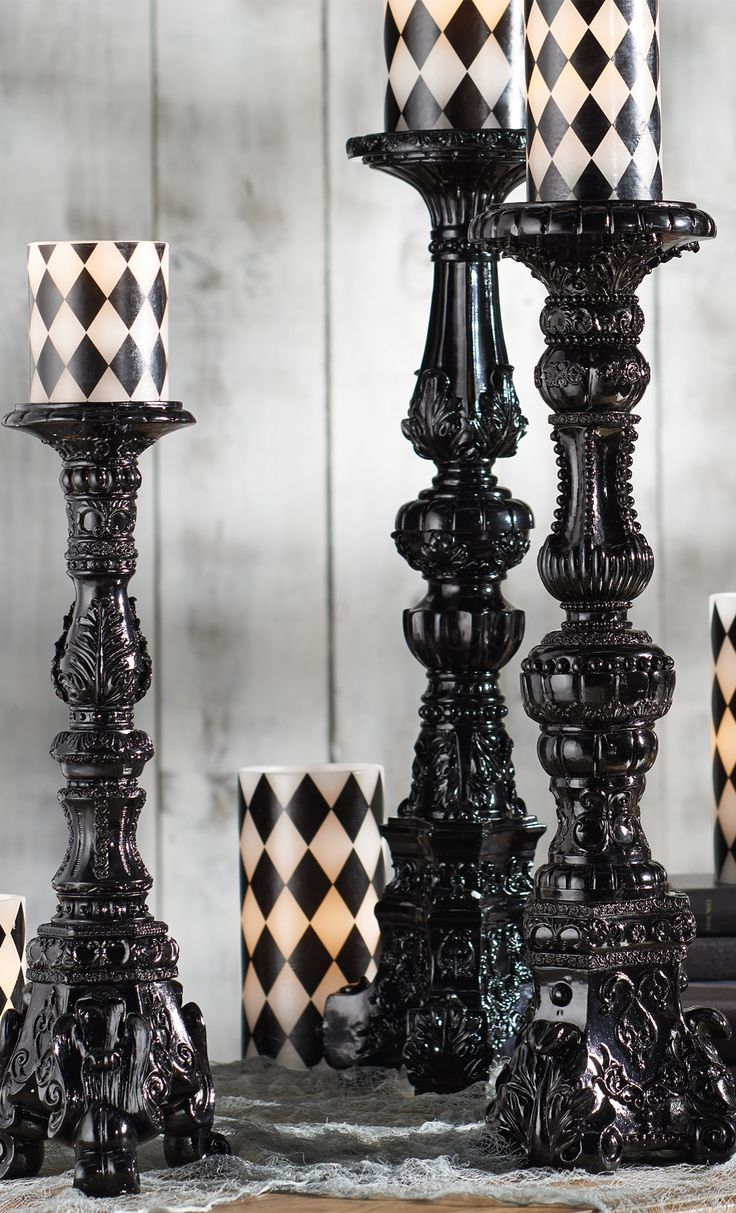 Tall and large ornate gothic candlesticks with black and white pillar candles