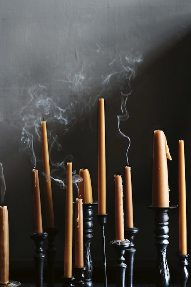 Tall black candlesticks with orange candles
