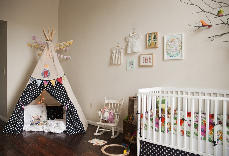 Teepee in nursery with fabric that matches the crib