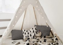 Teepee reading nook with clean colors patterns and lantern lights 217x155 15 Whimsical Teepee Reading Nooks for Kids