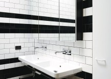 Tiny-black-and-white-bathroom-with-shower-area-217x155