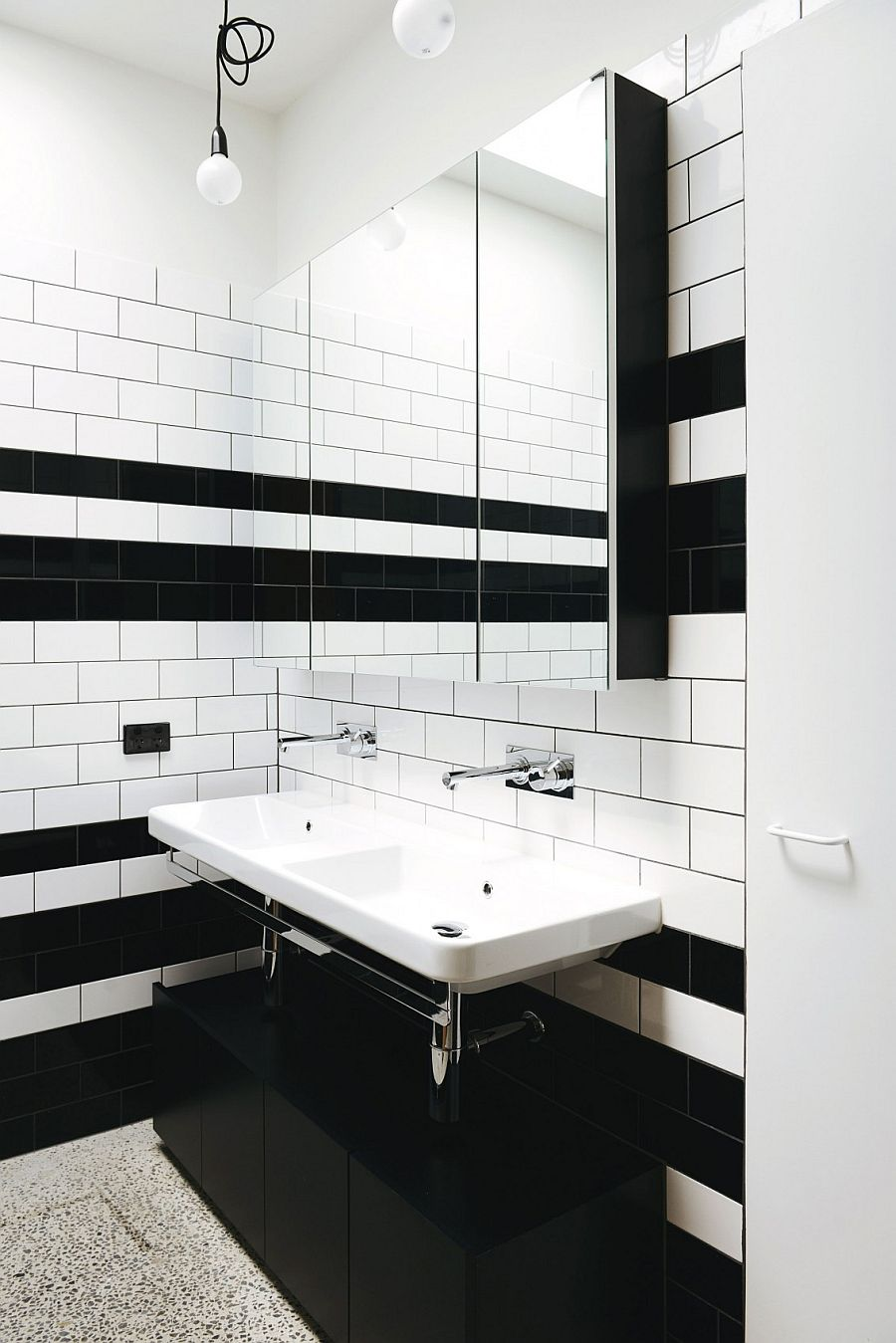 Tiny black and white bathroom with shower area