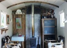 Tiny living room of refurbished railway wagon home