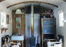 Tiny-living-room-of-refurbished-railway-wagon-home-217x155