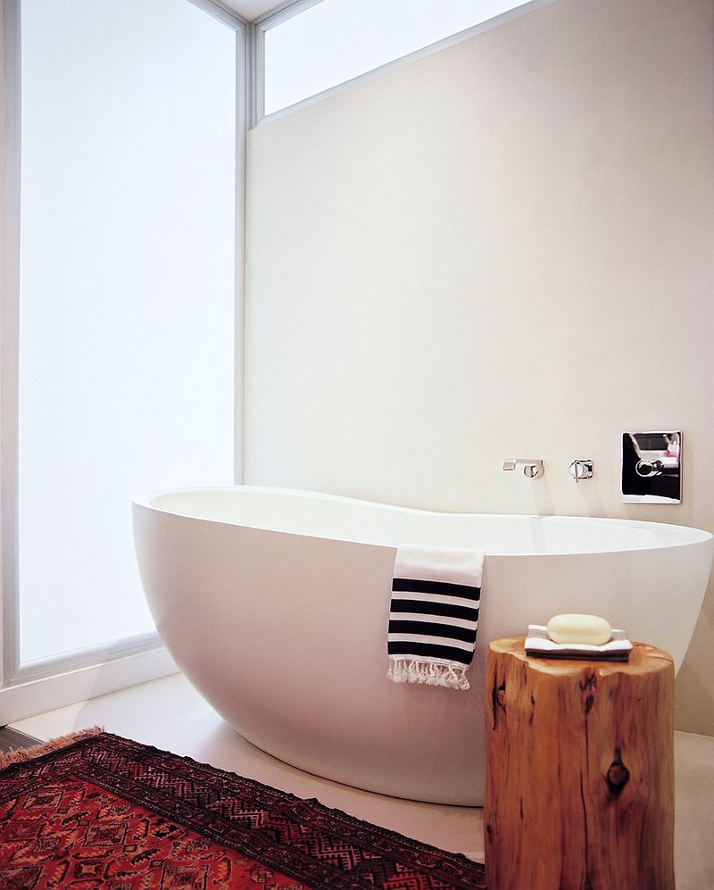 Tree stump stool used as side table next to the bathtub [Design: Scout Designs]