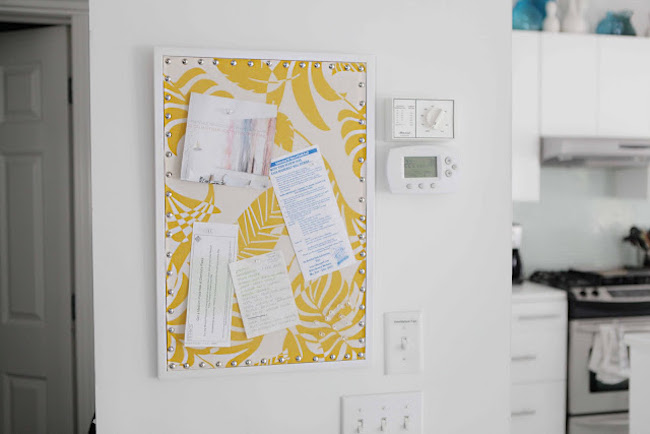 Tropical white and yellow fabric covering a cork board