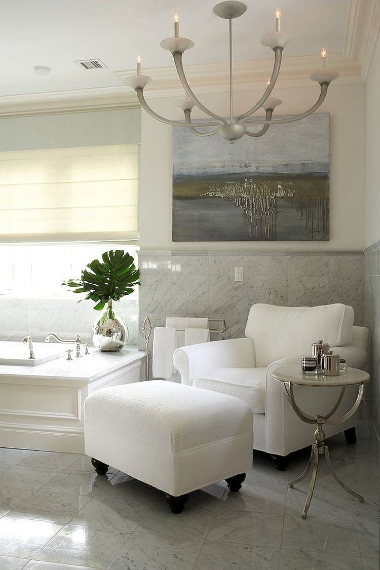Turn the bathroom into a relaxing hangout with club chair, ottoman and side table [Design: Lynne Scalo Design]