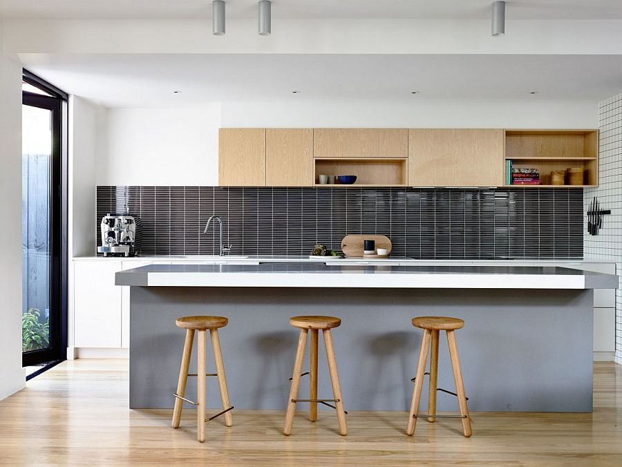 Upper kitchen cabinet and bar stools add warmth of wood to the modern kitchen