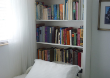 Use-a-bookshelf-as-a-headboard-for-small-rooms-217x155