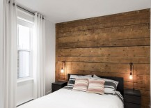 Wall of original wooden boards creates a lovely ambiance in the bedroom