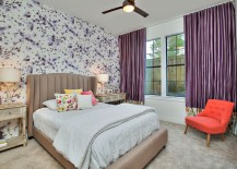 Wallpaper and drapes bring purple to the charming bedroom