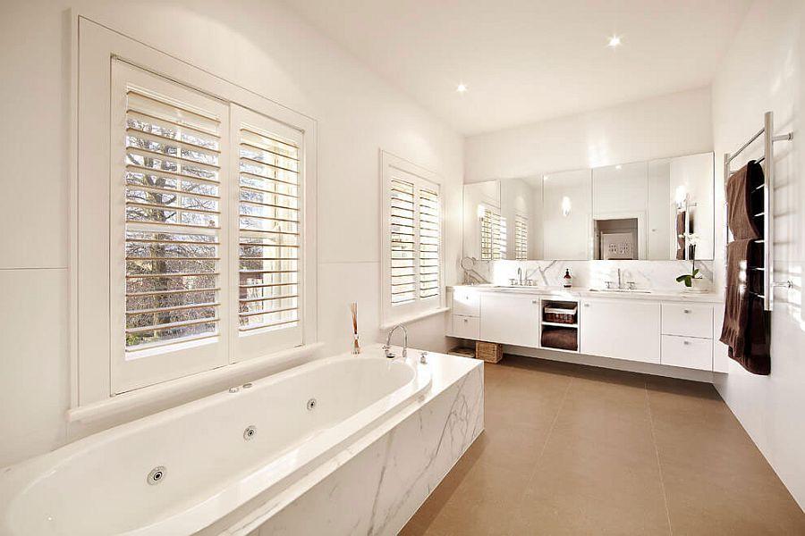 White bathroom design idea with a luxurious bathtub at its heart