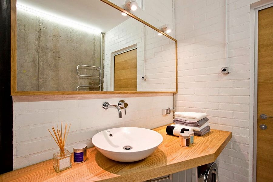 White brick walls give the bathroom a vintage appeal
