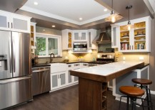 White recessed ceiling in a grey kitchen