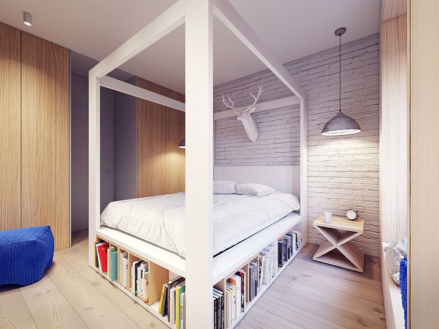 Whitewashed brick wall in the bedroom adds texture to the space