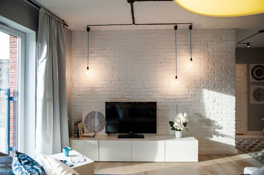 Whitewashed brick wall in the living and minimal industrial lighting