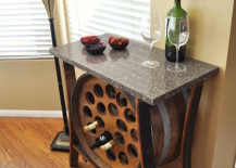 Wine barrel table with built in wine rack 217x155 8 Stunning Uses for Old Wine Barrels