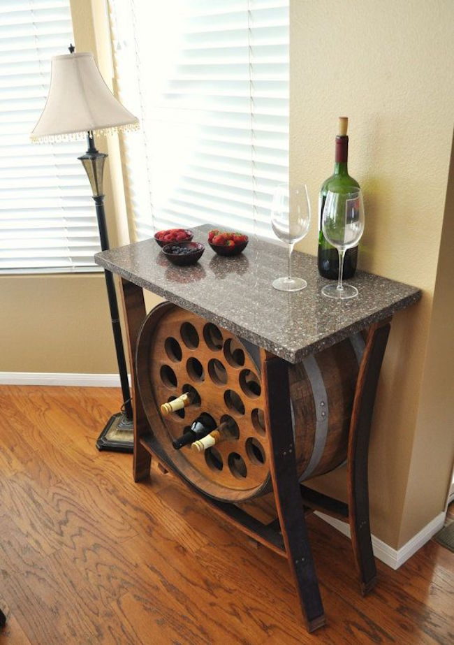 View in gallery Wine barrel table with built-in wine rack & 8 Stunning Uses for Old Wine Barrels islam-shia.org