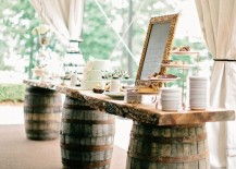 Wine barrels used to hold up the dessert table at a wedding 217x155 8 Stunning Uses for Old Wine Barrels
