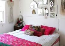 Wire pendant lights, bright accent pillows and colourful bedding shape the shabby chic bedroom