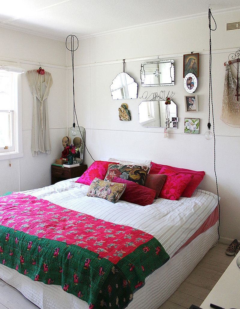 Wire pendant lights, bright accent pillows and colorful bedding shape the shabby chic bedroom [Design: Sweet William]