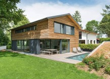 Wood and glass exterior gets a modern touch with pops of gray 217x155 Home in Oberhaching: Modern Minimalism Encased in Warmth of Wood
