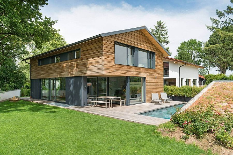Wood and glass exterior gets a modern touch with pops of gray