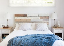 Wood panel headboard becomes a key elemnt in the shabby chic bedroom