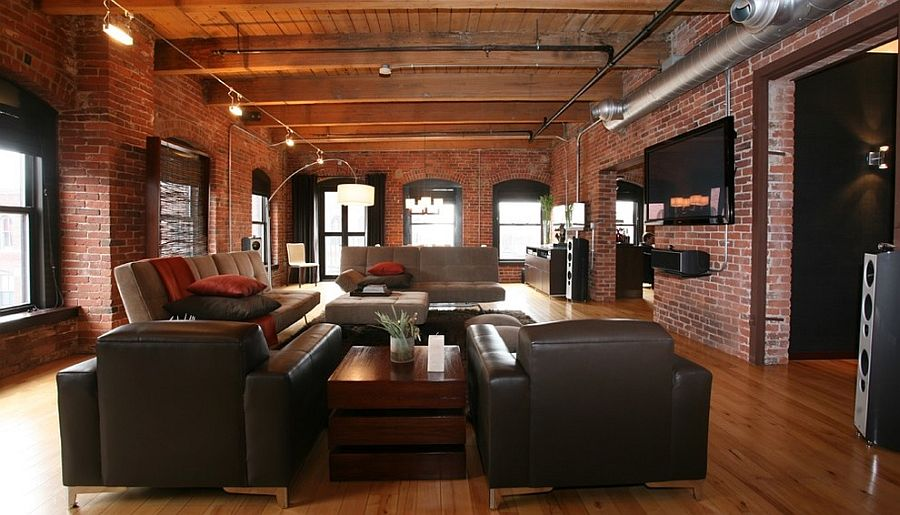 Wooden beams, brick walls and exposed duct pipes shape the cool industrial living room [Design: Nicole Hogarty]