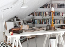 Work-station-with-bookshelves-along-the-wall-behind-it-217x155