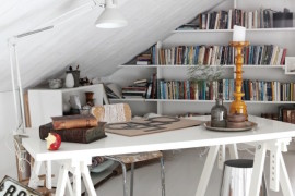 Work station with bookshelves along the wall behind it  15 Bright Attic Spaces for an Office or Studio Work station with bookshelves along the wall behind it
