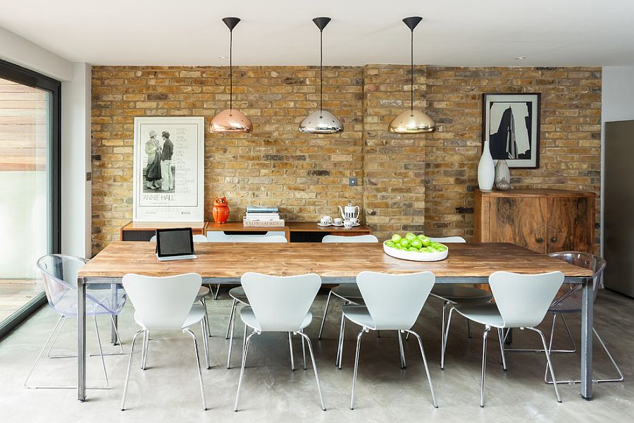 A Tom Dixon classic brings varying metallic shades to the contemporary dining space [Design: Casey & Fox]