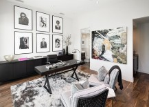 A-collection-of-black-and-white-framed-photographs-and-wall-add-to-the-neutral-color-scheme-217x155