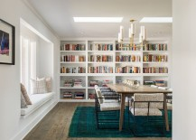 A flood of natural light and color scheme give the dining room an airy ambiance 217x155 Bibliophile Nirvana: 25 Dining Rooms That Serve Up a Good Read