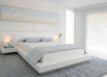 A perfect bedroom for those who love brick walls and loads of white! [Design: Habachy Designs]