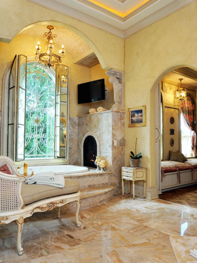 A tub with custom built-in fireplace fit for royalty