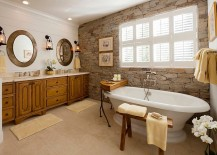 A wonderful blend of modern and traditional styles in the bathroom with stone wall