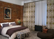 Accent brick wall in the bedroom with eclectic blend of prints [Design: 8.8 Design]