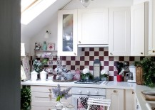 Ample natural light, color scheme and shabby chic style fashion a lovely attic kitchen