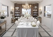 An all-white dining room captures the festive winter magic