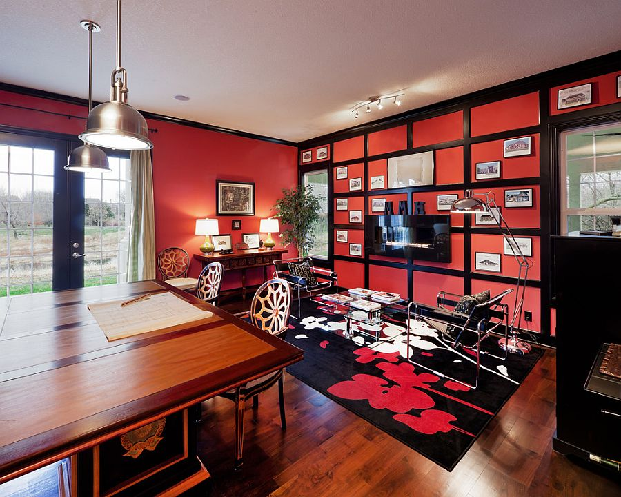 Antique red by Sherwin Williams gives the home office an energetic look [Design: Madi Mali Homes]
