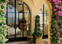 Arched entryway covered in greenery epitomizes the Mediterranean style entry 217x155 Tantalizingly Tuscan: Luxurious Malibu Villa Enchants with Mediterranean Magic