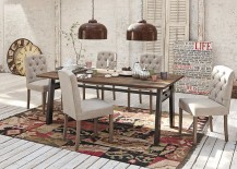 Area rug brings the different elements in the dining space together and defines it